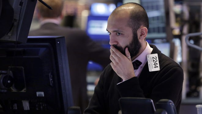 Specialist Fabian Caceres works on the floor of the New York Stock Exchange on Jan. 30.