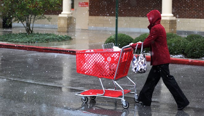 A shopper leaves a Target in Jones Valley, Ala., on Jan. 17. Some economists say consumer spending looks better than they expected in the wake of higher payroll taxes and late refunds.