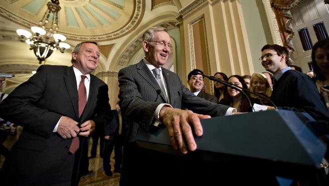 Senate Majority Leader Harry Reid speaks to reporters Tuesday in Washington.