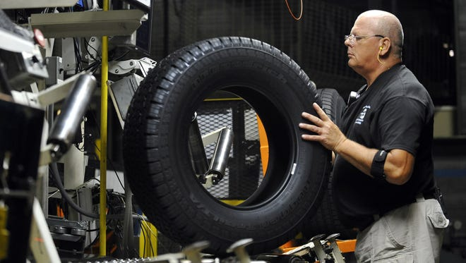 Inspector Buddy Rice checks a tire for defects at a Michelin plant in Greenville, S.C., last summer. Private-sector businesses added fewer jobs in March than expected.