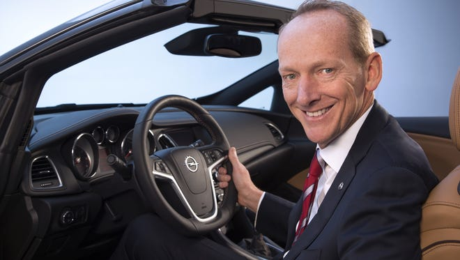 BOCHUM, GERMANY - UNDATED:  In this undated handout image provided by GM Company, Karl-Thomas Neumann poses in an Opel car as it is announced today he will become Chairman of the Management Board of Adam Opel AG effective March 1, 2013. In addition GM appointed Neumann President and Vice President of GM Europe and GM.  (Photo by GM Company/Handout via Getty Images)