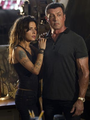 Sarah Shahi, left, and Sylvester Stallone star in the gory and poorly timed 'Bullet to the Head.'