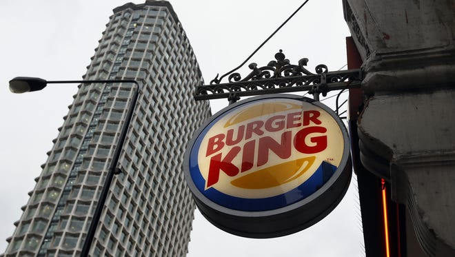 A sign hangs at a branch of Burger King in central London.