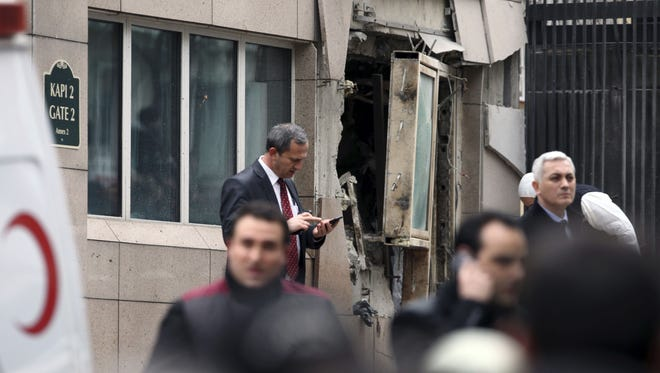 Damage is seen at an entrance to the U.S. Embassy in the Turkish capital, Ankara, after a suicide bomber detonated an explosive device on Friday.