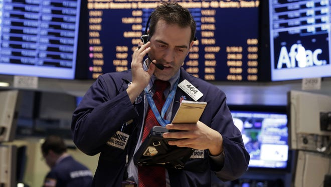 Trader Gregory Rowe works on the floor of the New York Stock Exchange.
