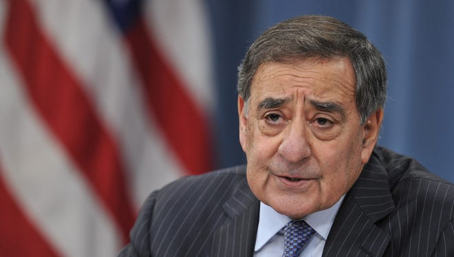 Defense Secretary Leon Panetta speaks to reporters on Jan. 24 at the Pentagon.