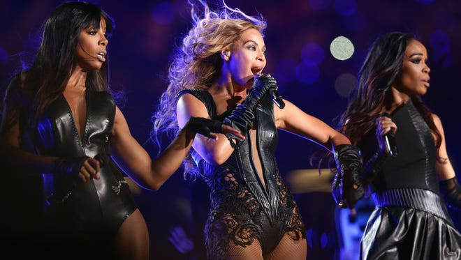 Beyoncé, center, with Kelly Rowland, left, and Michelle Williams of Destiny's Child, perform during the halftime show.