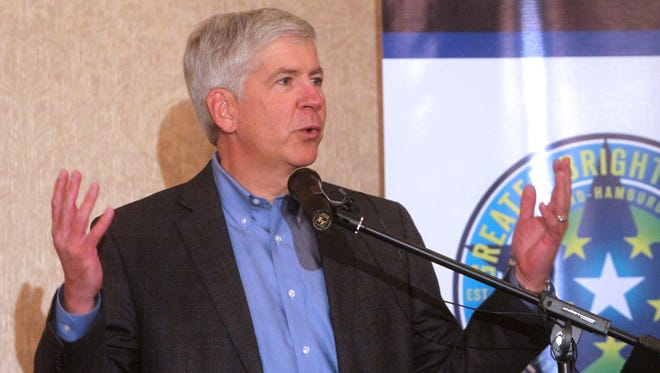 Michigan Gov. Rick Snyder addresses a gathering of local officials and business people at Crystal Gardens Banquet Center Thursday afternoon Jan. 17, 2013 in Genoa Township, Mich.