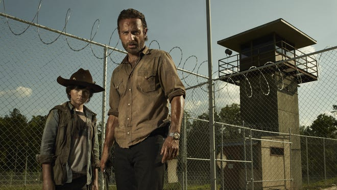 Up and 'Walking' around again: Rick Grimes (Andrew Lincoln) and son Carl (Chandler Riggs) return Sunday night.
