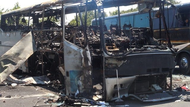 This image  provided by the Bulgarian Interior Ministry Thursday July 19, 2012, shows a damaged bus following Wednesday's deadly suicide attack on a bus full of Israeli vacationers at the Burgas airport parking lot, Burgas, Bulgaria. The attack occurred shortly after the Israelis boarded a bus outside the airport in the Black Sea resort town of Burgas, a popular destination for Israeli tourists ó particularly for high school graduates before they are drafted into military service. Burgas is about 400 kilometers (250 miles) east of the capital, Sofia. (AP Photo/Bulgarian Interior Ministry) ORG XMIT: VP106 [Via MerlinFTP Drop]