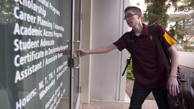 Arizona State University junior Greg Rudolph enters the W.P. Carey School of Business in Tempe, Ariz. on January 25.