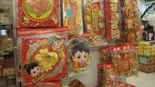 Decorations on sale at the Manila Market, an Asian supermarket in San Francisco. Millions of Americans are preparing for the Year of the Snake, which begins Sunday.