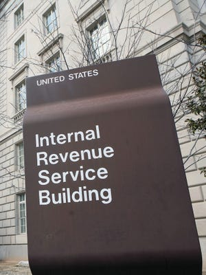 A sign identifies the IRS building in Washington, D.C.