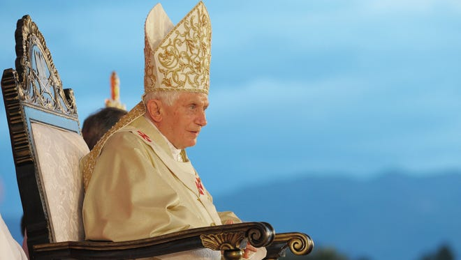 Pope Benedict XVI sits during a mass in Santiago de Cuba March 26, 2012.