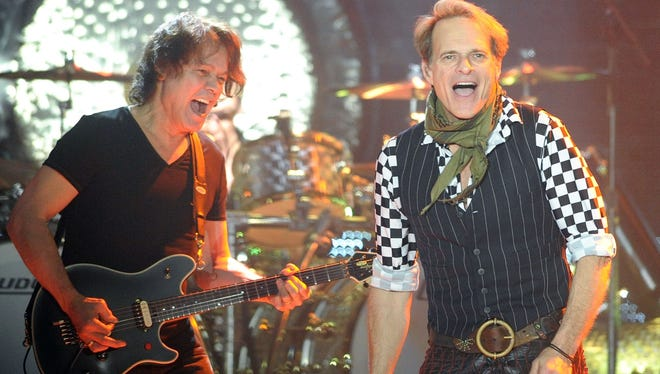 Van Halen guitarist Eddie Van Halen, left, and lead singer David Lee Roth, right, performs during a show March 26, 2012, at the Sovereign Center in Reading, Pa.