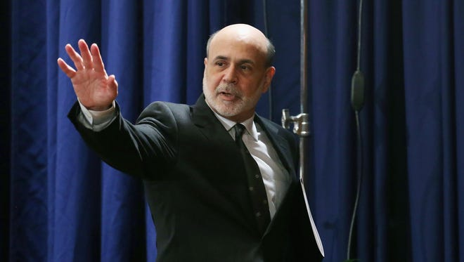 Federal Reserve Chairman Ben Bernanke waves to reporters after a press conference on Dec. 12, 2012, in Washington, D.C.