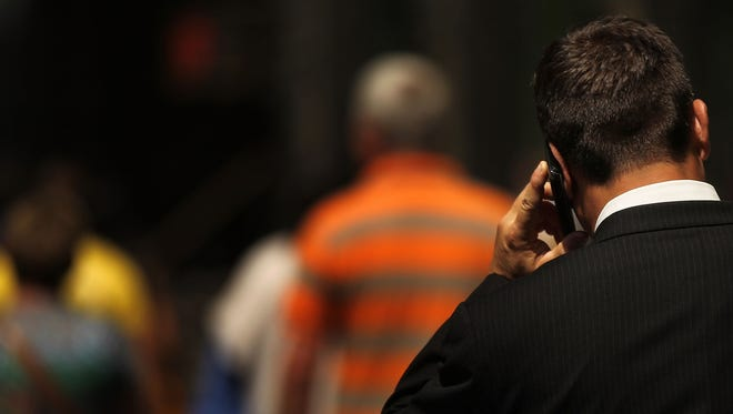 A man speaks on his mobile phone in New York City.