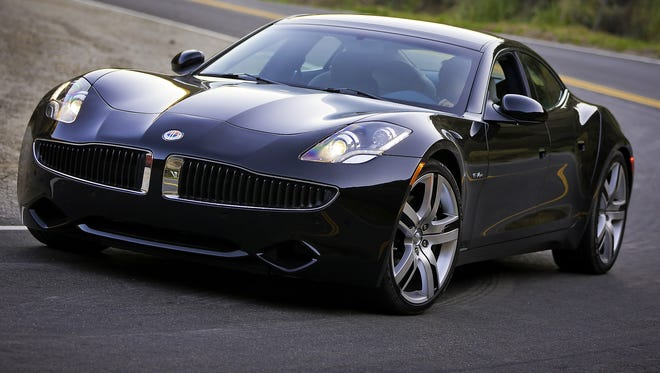 A Fisker Karma luxury sports sedan -- a plug-in electric car with a range-extending gasoline motor, a drivetrain similar to that of the Chevrolet Volt.