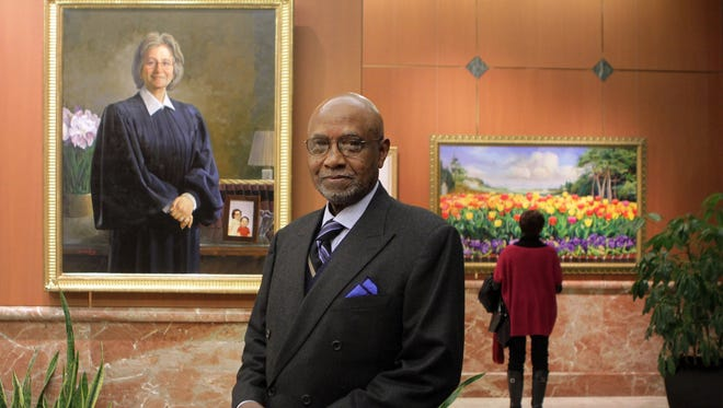 Simmie Knox stands among his paintings during a gallery preview of his works in Wilmington, Del. on February 1.