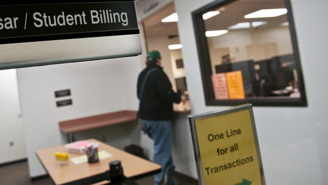 A University of Wisconsin-Green Bay student visits the student billing office in Green Bay, Wis., on Feb. 4. More than $33.5 billion in Pell Grants were issued to students last year.