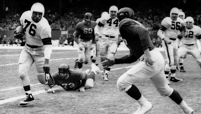 Cleveland Browns Hall of Fame fullback Marion Motley (76) against the New York Giants in a 1950 game.