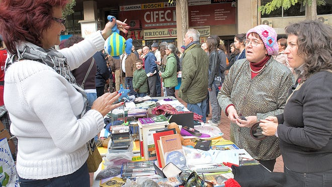 Books, toys, movies and video games for sale at this bartering market in Barcelona, Spain.