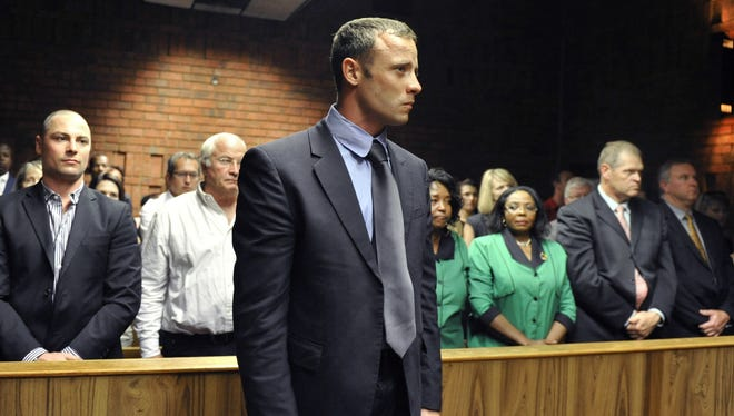 Olympian Oscar Pistorius stands following his bail hearing in Pretoria, South Africa, on Tuesday.