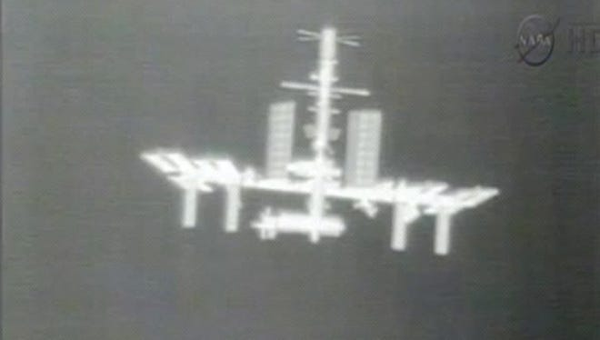 This Thursday, May 24, 2012 image made from video provided by NASA-TV shows the International Space Station taken from the thermal imaging camera aboard the SpaceX Dragon commercial cargo craft as it approaches the station.
