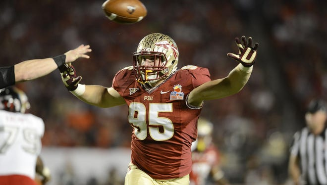 Florida State Seminoles defensive end Bjoern Werner (95) pressures in the second quarter of the game against the Northern Illinois Huskies at the 2013 Orange Bowl at Sun Life Stadium.