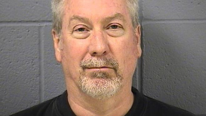 This May 7, 2009 file photo provided by the Will County, Ill., Sheriff's office shows former Bolingbrook, Ill., police officer Drew Peterson.