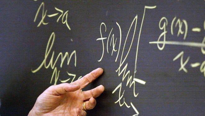 Sr. Alice Hess a mathematics teacher at Archbishop Ryan High School in Philadelphia at the blackboard during calculus class at the high school.