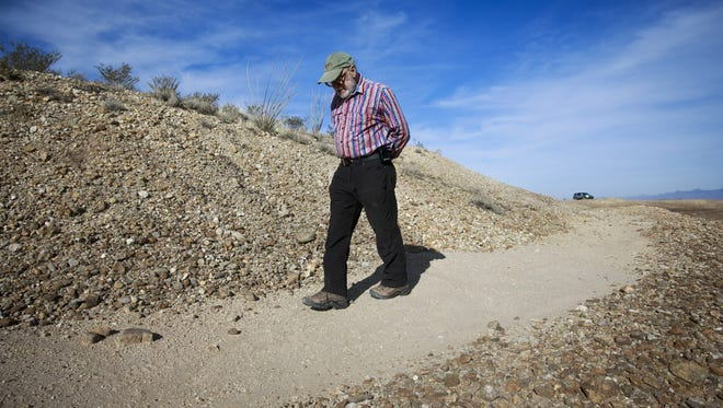 Engineer and part-time archaeologist Don Lancaster walks along the remnant of the Mud Springs canal on January 23 in Arizona.
