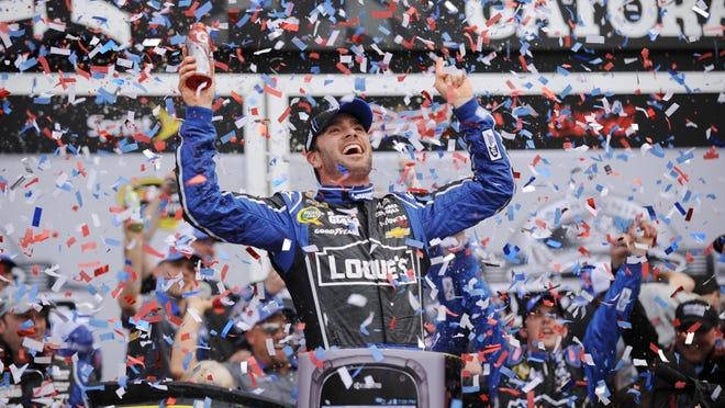 Jimmie Johnson celebrates in victory lane after winning the 2013 Daytona 500.