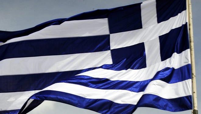 A Greek flag flies.