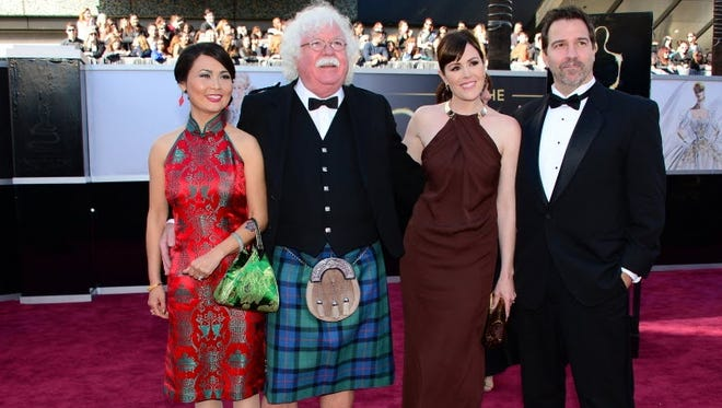 The MacFarlane clan: Host Seth MacFarlane's dad Ron sports a brand new kilt on the red carpet. (He's seen here with wife  Xiao Xiang,  daughter Rachael MacFarlane and her guest.