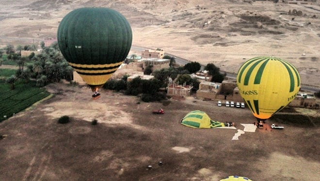 Balloons fly near the launch site near Luxor in Egypt, shortly before an explosion that killed 19 people, most of them tourists, on Feb. 26.