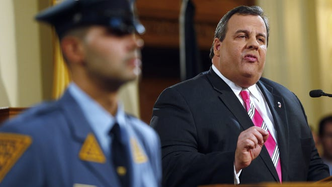 New Jersey Gov. Chris Christie gestures as he gives details on his 2014 state budget in Trenton, N.J., Tuesday, Feb. 26, 2013. Christie delivers his fourth budget proposal before a joint session of the Legislature at the State House during an election year as the state rebounds from the worst natural disaster in its history.