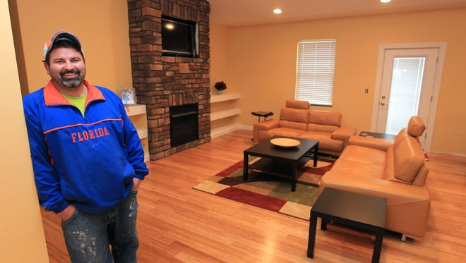 Doug Imhoff shows his rebuilt home Feb. 27 in Piner, Ky. A tornado destroyed his home March 2, 2012.