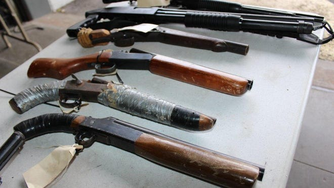 Sawed-off shotguns were among the weapons claimed by law enforcement authorities in Florida.