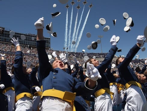 Air Force Academy graduates celebrate as a team of F-16 ...