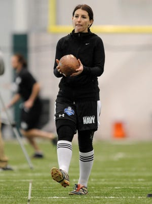 Lauren Silberman warms up at the Atlantic Health Jets Training Center during an NFL regional combine event in Florham Park, N.J. on March 3, 2013.
