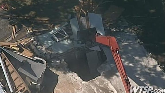 Demolition on Monday revealed the giant sinkhole that opened beneath a Seffner, Fla., home.