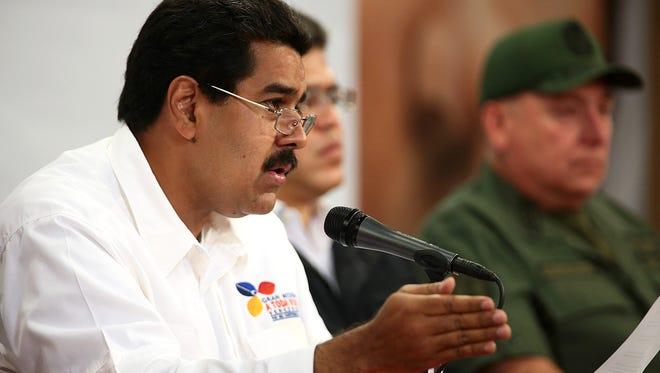 Venezuelan Vice President Nicolás Maduro discusses the political path for Venezuela on Tuesday before the death of President Hugo Chávez.