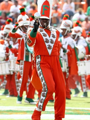 In this Oct. 8, 2011 photo, Florida A&M Drum Major Robert Champion performs during a during a  game against Howard University.