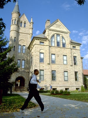 A student walks past Peters Hall at Oberlin College in Oblerin, Ohio.