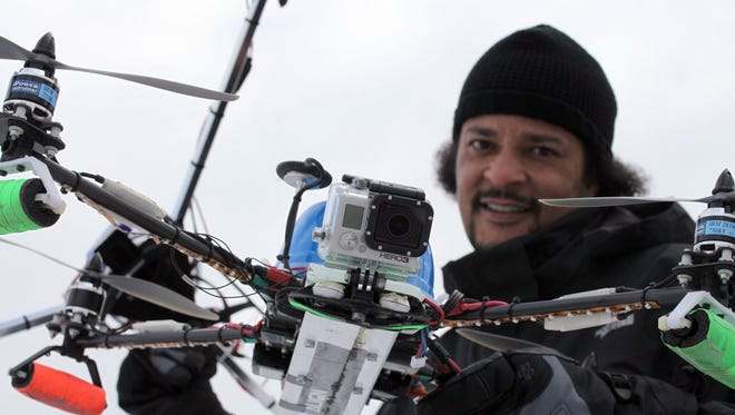 Harry Arnold prepares to use a drone for aerial footage of the ongoing construction of a Wayne State University building in Detroit on Feb. 2.