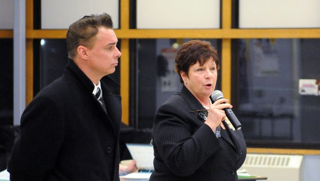 """Deborah Haab, right, Highland Central School District superintendent, speaks during a board meeting March 5 in Lloyd, N.Y. At left is Lloyd Police Chief Daniel Waage. The school district school resource officer program is on hold while an investigation is conducted into a Lloyd police officer's gun being """"accidentally discharged"""" in the high school."""