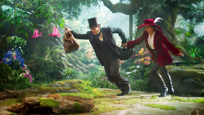 James Franco, left, and Mila Kunis star in the entertaining and visually enchanting 'Oz the Great and Powerful.'