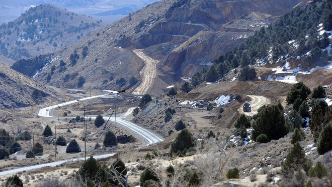 A truck moves down a new haul road Feb. 26 at the Comstock Mine south of Gold Hill, Nev.