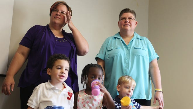 April DeBoer, left, and her partner, Jayne Rowse, stand Sept. 9 with their children, Nolan DeBoer-Rowse, left; Ryanne DeBoer-Rowse; and Jacob DeBoer-Rowse. The couple wants joint custody of the children and say they would gladly marry to be able to adopt the children.